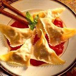 Easy Cheesy Chicken Ravioli Recipe - Purchased wonton wrappers stand in for pasta in this homemade ground chicken ravioli recipe for two.