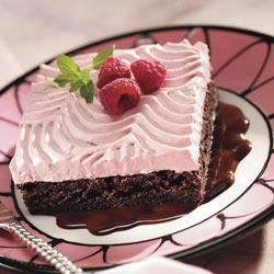 Red Raspberry Chocolate Brownie Recipe - Swirled raspberry cream tops these brownies for an easy but beautiful dessert. For an elegant touch, serve on a pool of chocolate syrup.