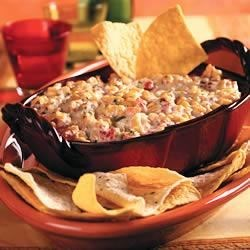 Hot Corn Dip Recipe - Colorful and spicy, this creamy tortilla chip dip is a blend of corn, tomatoes and spices.
