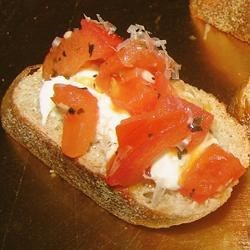 Carrie's Bruschetta Appetizer Recipe - This yummy bruschetta recipe is for anyone who likes feta cheese and tomatoes, and is great for dinner parties. Assemble while the ingredients are still warm so the mozzarella will melt slightly.