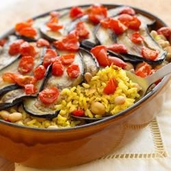 Vegetarian Oven-Baked Brown and Wild Rice with Eggplant Recipe - Begin with Uncle Ben's(R) Rice and end up with a delicious vegetarian dish. Skillet browned with eggplant, garbanzo beans, and freshly chopped tomatoes.