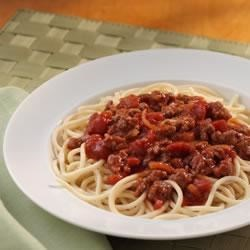 Classic Spaghetti Meat Sauce Recipe - Stewed tomatoes, tomato sauce and onion soup mix combine with ground beef for a super sassy sauce!