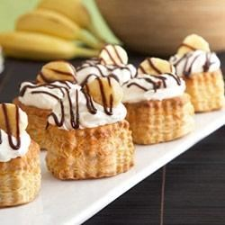 Black Bottom Banana Cream Puffs Recipe - Hot fudge, bananas, pudding, puff pastry and whipped cream...with those ingredients, these individual dessert shells are guaranteed to be delicious!