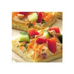 Thai Appetizer Pizza Recipe - Bold flavors star on a flaky pastry crust crowned with sassy ginger, peanut and veggie toppings.