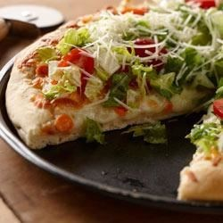 Tossed Salad Pizza Recipe - Pizza and a salad are always a great combo, now it's all in one pizza! Use your family's favorite vegetables in the salad.