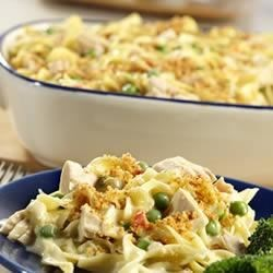 Classic Tuna Noodle Casserole Recipe - Tuna tossed with noodles, peas and pimiento in a creamy sauce is baked until bubbling with crunchy crumb topping.