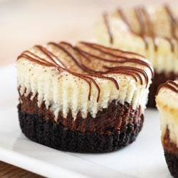 Mini Chocolate Hazelnut Cheesecakes Recipe - Pretty little cappuccino-hazelnut cheesecakes are dusted with cocoa and topped with a drizzle of mocha-hazelnut.