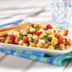 Mediterranean Chickpea Salad Recipe - Next time your family is in the mood for a vegetarian entree, try this fresh, bright chickpea salad recipe. It's simple. Just open a can of GOYA(R) Low Sodium Chick Peas! Toss with sweet cherry tomatoes, crunchy cucumber, and cubes of soft, creamy Mozzarella cheese. A splash of buttery GOYA(R) Extra Virgin Olive Oil and a drizzle of tangy lemon juice make this sunny, Mediterranean Chickpea Salad a delicious lunch or dinner, any day of the year.