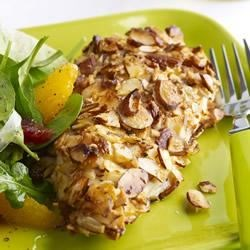 Almond Orange Crusted Chicken with Fennel Arugula Salad Recipe - Traditional chicken dinner gets a modern-day makeover with sliced almonds and orange zest to perk up an old standby. Use the left over orange slices for a refreshing side salad with arugula, fennel and lemon juice.