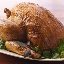 Chiarello's Herb Roasted Turkey Recipe - Rosemary, thyme, sage, and oregano--fresh herbs bring out the rich flavors of roasted turkey and vegetables served with lots of gravy.