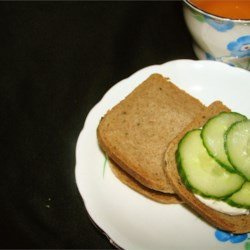 Party Cucumber Sandwiches Recipe - Cocktail rye bread is spread with cream cheese and mayonnaise and layered with cucumber and onion, for refreshing, dainty finger sandwiches.