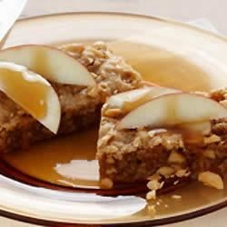 Apple Caramel Bars Recipe - We're pretty sure that this is the reason Johnny Appleseed got into the apple tree planting business--so that you could mix them with caramel and peanuts and make these delicious bars. Make these tasty treats at home with a little help from Duncan Hines and other items found in the baking section of your grocery store.