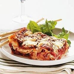 Red Pepper Lasagna Recipe - Tangy goat cheese and a splash of red wine turn a simple lasagna into something special.