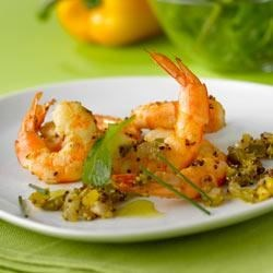Maille(R) Dijon Shrimp Starter Recipe - Fresh shrimp with onion, bell pepper, and garlic in a mustard sauce are served atop fragrant garden herbs in this easy starter course.