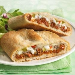 Easy Stromboli Recipe - Stromboli is a family dinner favorite. Make it easy when you roll up pizza toppings in a pizza crust.