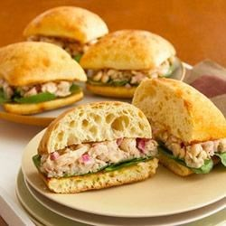 Tuscan White Bean and Tuna Sandwiches Recipe - Hold the mayo on these tuna sandwiches! Instead, use an oil and vinegar combo to flavor a tasty spread made with tuna, beans and just a little onion.