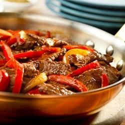 Steak with Bell Peppers Recipe - Get ready to sizzle...red peppers, onion, garlic and strips of beef sirloin make a tasty stove-top dish that the whole family will enjoy.