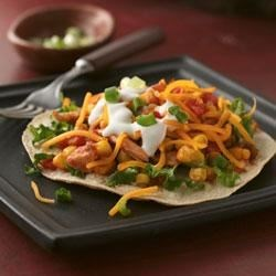 Shredded Chicken and Corn Tostadas Recipe - Put a flavorful chicken fiesta on your dinner table in less than 30 minutes!