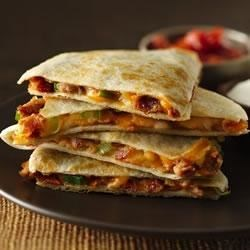 Cheesy Bacon-Bean Quesadillas Recipe - The added bacon and scallions in this quesadilla give a surprising and delicious flavor boost!