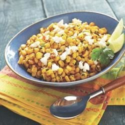 Corn Mexican-Style Recipe - Fresh cilantro, lime juice, and crumbled queso fresco make this spicy corn side dish a true stand out.