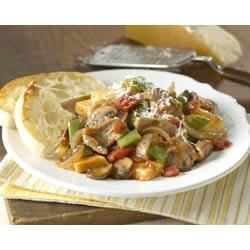 Tuscan Pork Stir-Fry Recipe - Inspired by the fresh, simple ingredients of Tuscany, this quick-to-prepare dish uses Italian-styled tomatoes, seasoned with basil, for a light sauce that complements the subtle flavor of pork tenderloin.