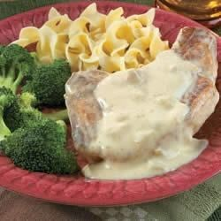 Campbell's(R) Easy Skillet Pork Chops Recipe - For a quick, hearty dinner, serve these creamy pork chops with a side of egg noodles.