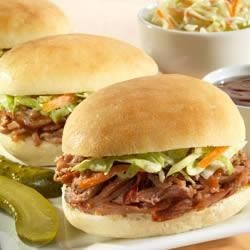 Sister Schubert's(R) Barbecue Pulled Pork or Chicken Mini-Sliders Recipe - Use your favorite prepared pork, beef or chicken barbecue for these mini-sliders with fresh coleslaw.