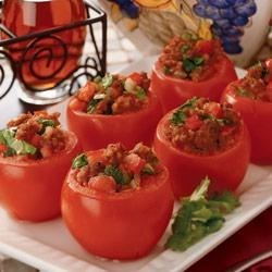 Sausage Stuffed Tomatoes Recipe - Fresh tomatoes are stuffed with a mixture of Johnsonville® Italian Sausage, caramelized onion, spinach, garlic and sherry for a truly one-of-a-kind taste!