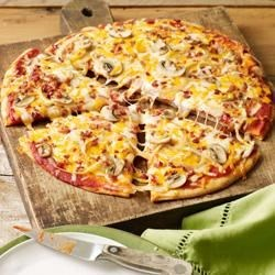 Bacon-Mushroom Pizzeria Pizza Recipe - This pizza, made with Cheddar and mozzarella cheese plus bacon, is a savory, flavorful dish that's perfect for a quick lunch or supper.