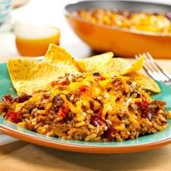 Southwest Skillet by Campbell's Kitchen Recipe - Just one skillet is all you need to make this zesty beef dish made with tomatoes, kidney beans and instant rice. It's topped with Cheddar cheese and served with tortilla chips...now doesn't that sound good?
