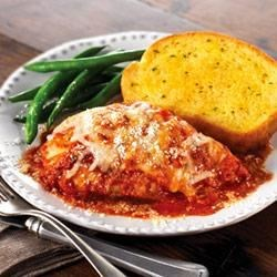 Chicken Parmesan Bake Recipe - In less than an hour, you can make this simply delicious chicken dish, baked in a flavorful tomato sauce and topped with mozzarella and Parmesan cheeses. It's a winner!
