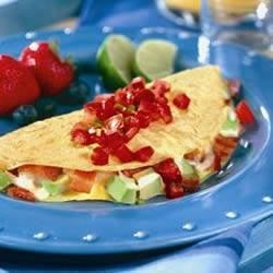Bacon, Avocado and Cheese Omelet Recipe - This Caribbean styled omelet recipe makes a tasty meal for lunch, dinner and, of course, breakfast.