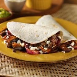 Mushroom and Onion Vegetarian Tacos Recipe - Vegetarians and meat-lovers will both love these delicious tacos. Mushrooms provide 'meaty' and filling flavor, balanced out by sweet caramelized onions.