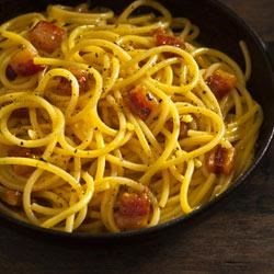 Coal Miners'-style Spaghetti Recipe - Crispy pancetta-Italian bacon-and a creamy pasta sauce of Parmigiano-Reggiano cheese and eggs meld with spaghetti to create a quick but satisfying classic dish.