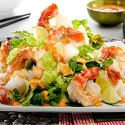 Spicy Shrimp with Bang Bang Sauce Recipe - Spicy shrimp are roasted and served over lettuce, topped with crushed potato chips, and served with a zesty hot sauce.