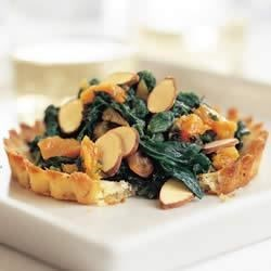 Spinach and Apricot-Filled Almond Tarts Recipe - These  easy to make tarts are filled with spinach, slivered California Almonds, and dried apricots.