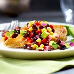 Fiesta Chicken and Black Beans Recipe - Turn boneless, skinless chicken breasts into a vibrant, healthful one-pot meal with plump GOYA(R) Low Sodium Black Beans, sweet red onion, crunchy red bell pepper, and creamy avocado. Add your favorite salad or cornbread for a sensational black bean chicken dinner in just 30 minutes.
