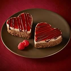 Ghirardelli Chocolate Raspberry Cheesecake Hearts Recipe - This decadent double-layer chocolate and raspberry cheesecake is irresistibly delicious for any special occasion.