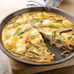 Frittata Primavera Recipe - The fresh veggies in this frittata are ideal for a light brunch while the PHILADELPHIA Cream Cheese adds a decadently creamy quality.