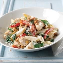 Creamy Chicken Florentine Recipe - Red peppers, fresh spinach and tasty boneless chicken are combined with PHILADELPHIA Savory Garlic Cooking Creme, tossed with hot pasta and finished with toasted pine nuts--sure to make for an easy but sophisticated meal!