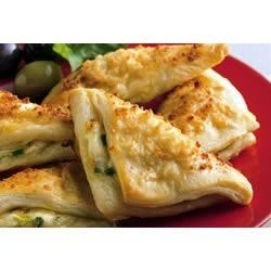 Cheese Crescent Triangles Recipe - Tender crescent bites hold a warm, cheesy filling in a crowd-pleasing appetizer.