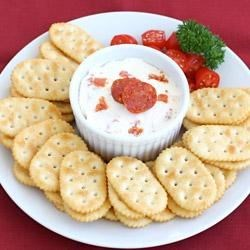 Zesty Pepperoni Spread Recipe - Cream cheese mixed with chopped pepperoni is garnished with halved cherry tomatoes and served with crackers for an easy and delicious appetizer!