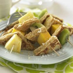 Whole Grain French Toast and Tropical Fruit Kabobs Recipe - Tropical fruit and a hint of lemon zest lift these whole grain bites above the ordinary.