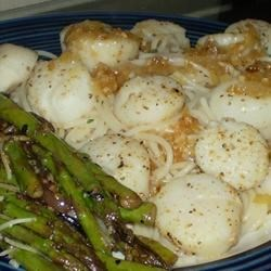 Scallops with White Wine Sauce II Recipe - White wine, butter, and shallots make a great sauce for scallops. This is easy and non-creamy for those that don't like cream sauces.