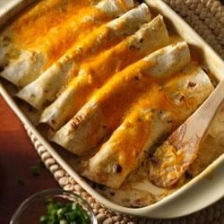Progresso(R) Chicken Enchiladas Recipe - The cooking sauce is the secret for making these enchiladas super creamy and full of flavor.
