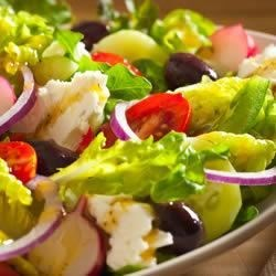 Greek Salad by Filippo Berio(R) Recipe - Loaded with fresh salad veggies like lettuce, radishes, bell pepper, cucumber, and tomatoes and seasoned with a blend of herbs, this salad is finished with extra virgin olive oil and red wine vinegar for a light lunch or dinner side.