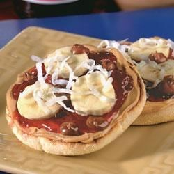 Peanut Butter and Jelly Pizza Recipe - An English muffin is topped with peanut butter, strawberry preserves, bananas, and hot fudge in this quick, kid-friendly snack.