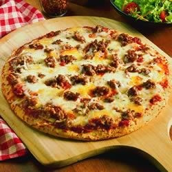Quick and Easy Pizza Recipe - This quick and easy pizza is topped with zesty hot sausage and mozzarella.