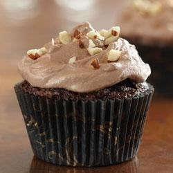 Brownie Cupcakes with Hazelnut Buttercream Recipe - These easy brownies are loaded with chopped hazelnuts, then they're topped with swirls of creamy chocolate-hazelnut frosting.