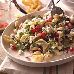 Creamy Mediterranean Pasta Salad Recipe - A perfect summer lunch or dinner, this pasta salad with spinach, grape tomatoes, and crumbled feta cheese is tossed with a creamy lemon and herb sauce.